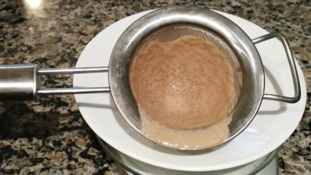 kos protein powder in strainer
