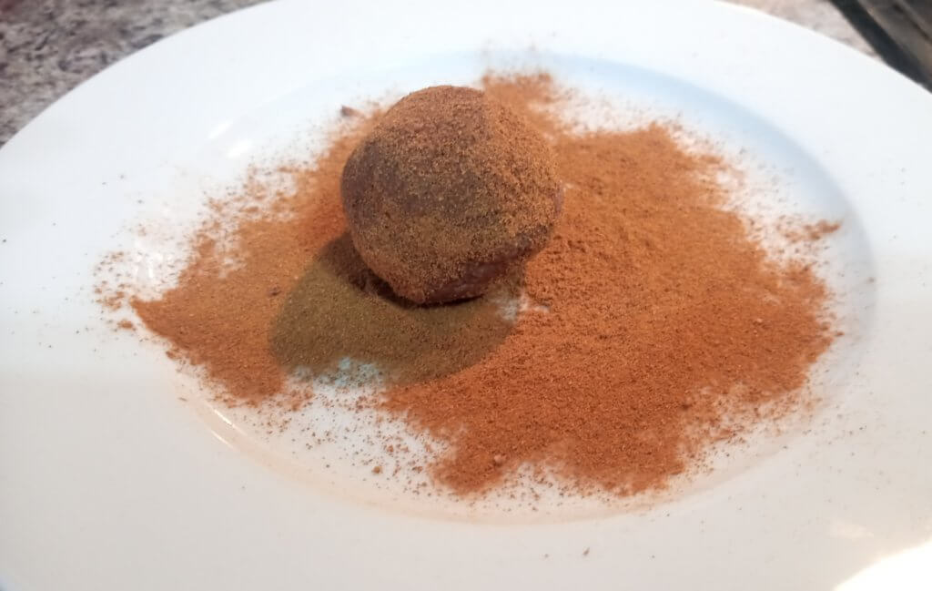 protein balls roll in cinnamon